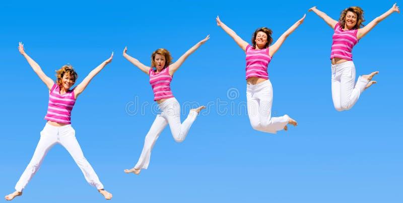 женщины группы скача стоковые изображения