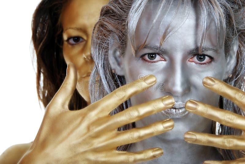 женщины золота серебряные стоковое фото rf