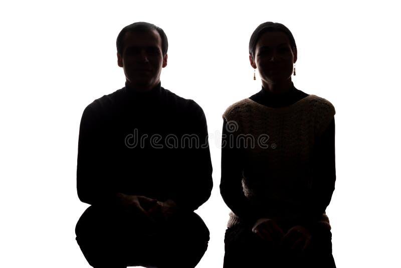 Женщины и люди поперек от, брат и сестра портрета - силуэт стоковые фото