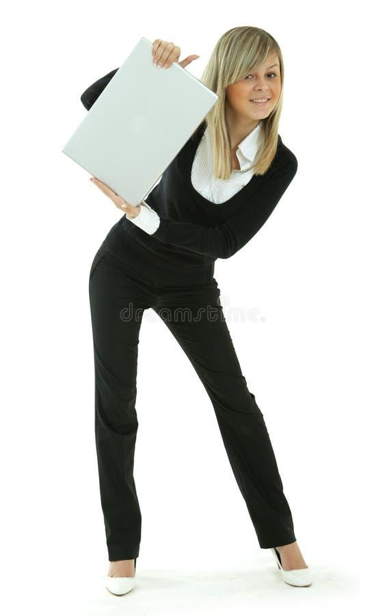 женщины компьтер-книжки молодые стоковое фото