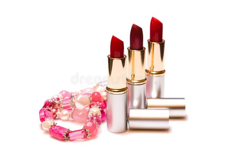 женщины красного цвета губной помады ювелирных изделий стоковое изображение