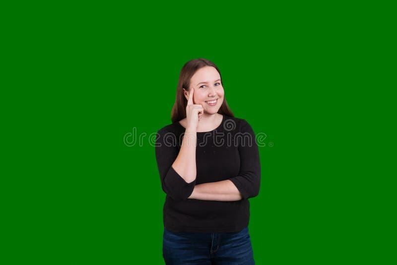 Женщины указывая палец для того чтобы возглавить выражение иметь отличную идею стоковая фотография rf