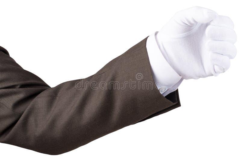 Жест кулака руки в перчатке изолированной на белизне стоковые фото