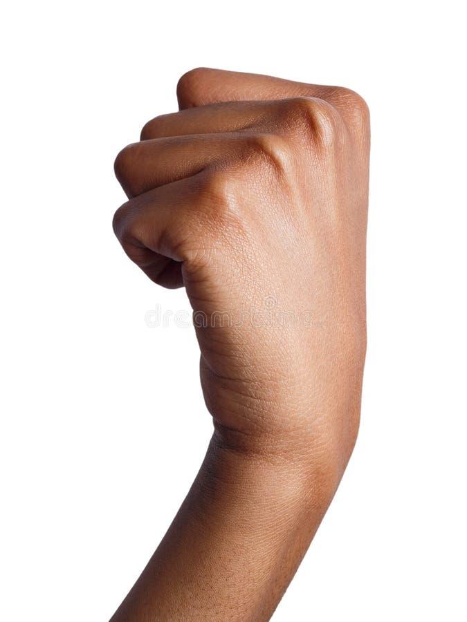 Жест рукой, сжатый кулак женщины, подготавливает для того чтобы пробить стоковое фото rf