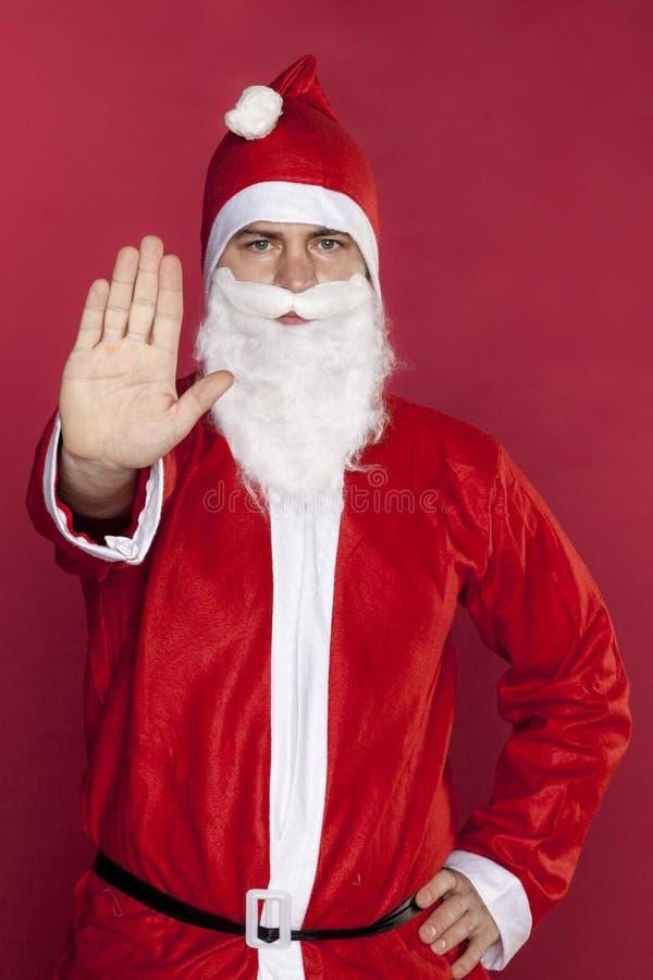 Жест стопа выставок Санта Клауса для ходить по магазинам стоковое изображение