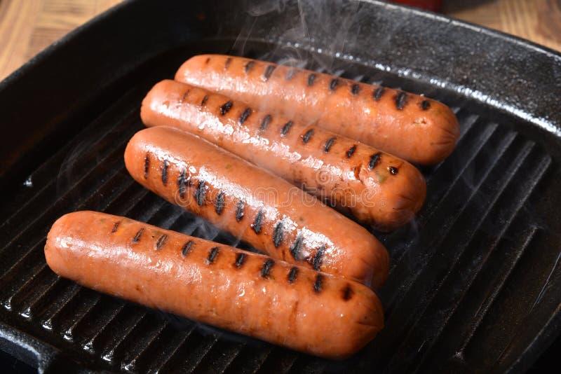 жечь собак горячий стоковые изображения