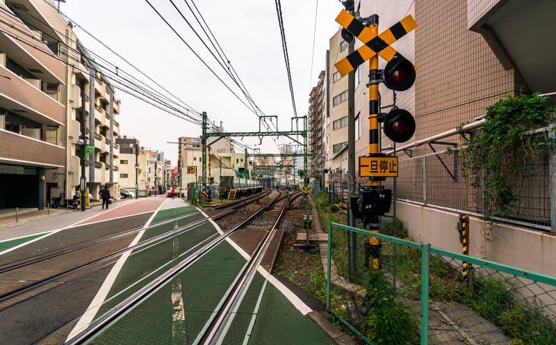 Железнодорожный переезд в токио стоковые изображения