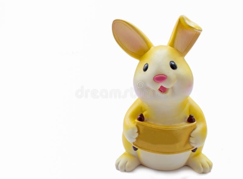 Желтая копилка кролика стоковое изображение rf