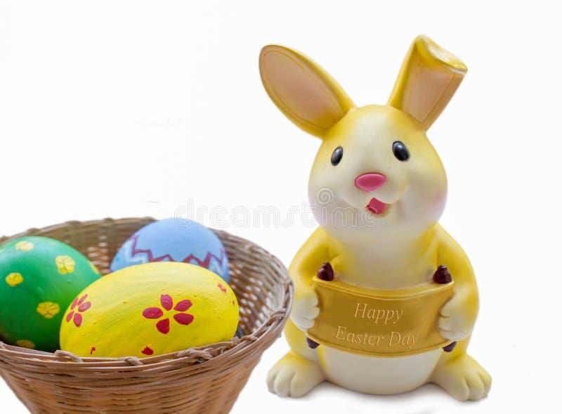 Желтая копилка кролика стоковое фото