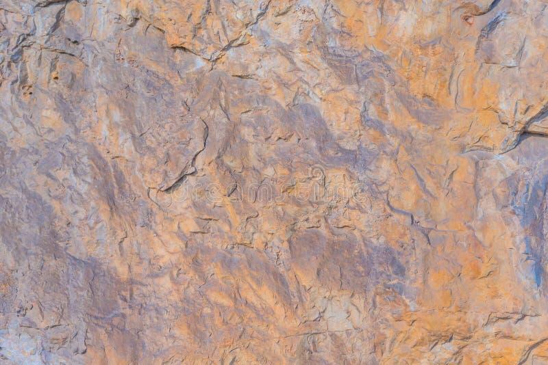 Желтая оранжевая каменная поверхностная текстура стоковое изображение