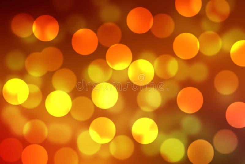желтая оранжевая накаляя светлая предпосылка щетки и обоев Bokeh стоковые фото