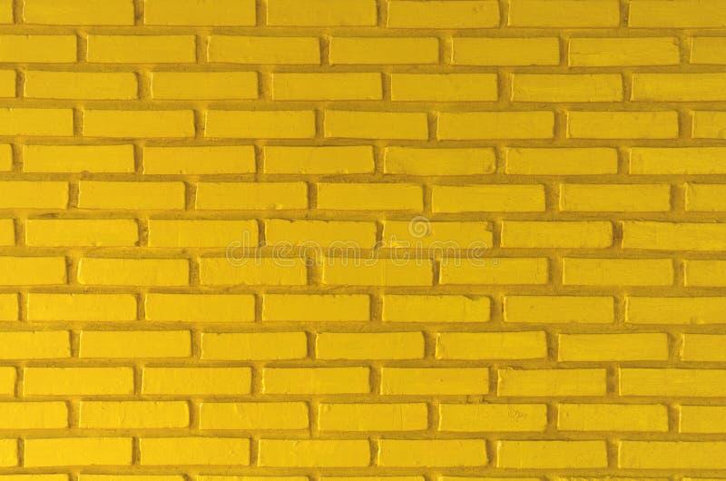 Желтая предпосылка текстуры кирпичной стены стоковое изображение