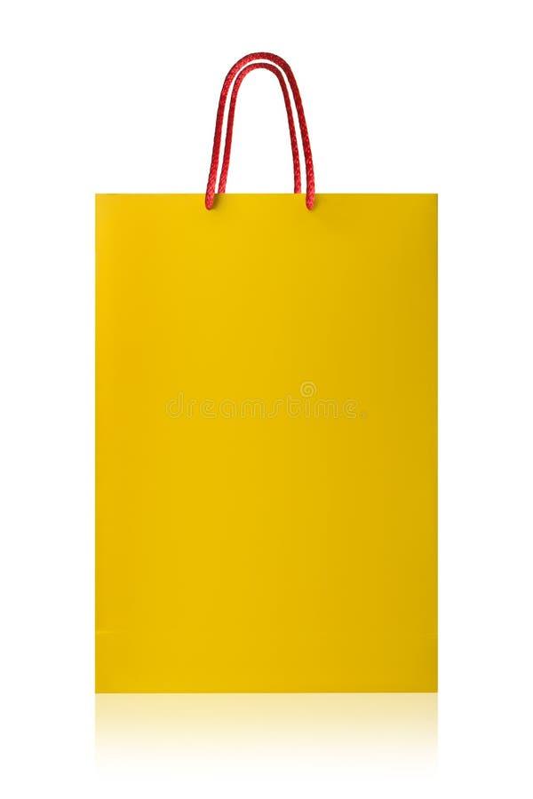 Желтая хозяйственная сумка, с путем клиппирования на белом backgr стоковое фото