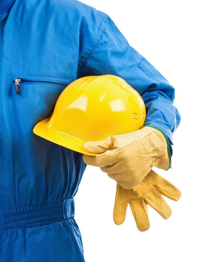 Желтый защитный шлем под рукояткой стоковое фото