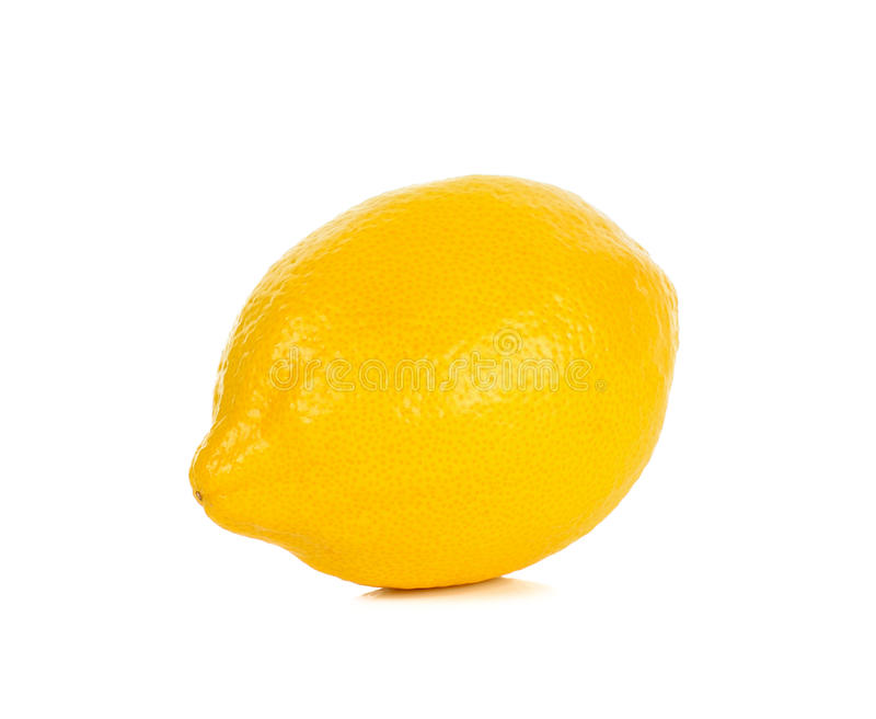 Желтый лимон изолированный на белой предпосылке стоковое фото