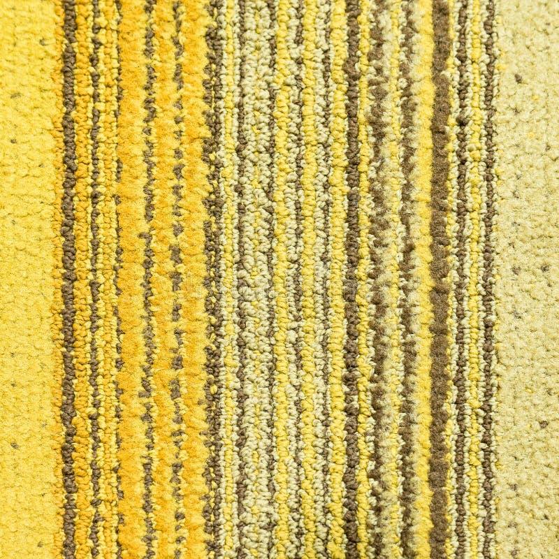 Желтый ковер нашивки стоковые фотографии rf