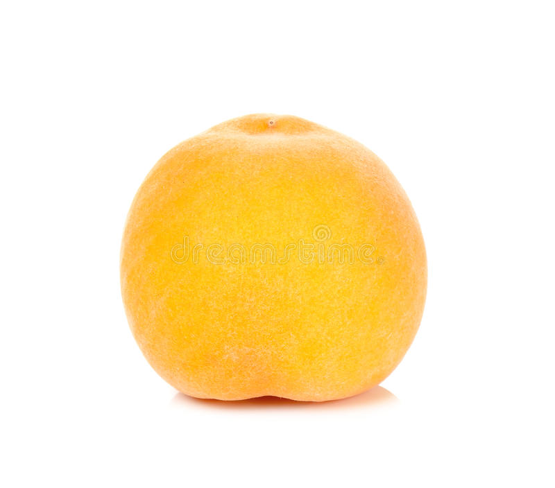 Желтый персик изолированный на белой предпосылке стоковая фотография