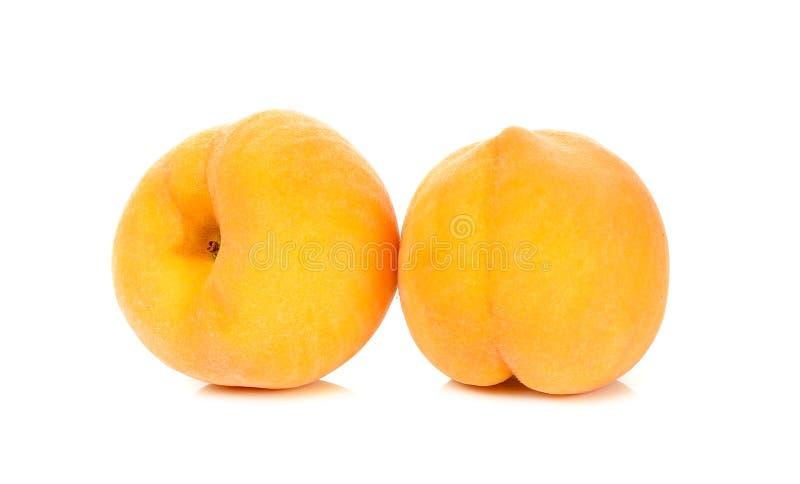 Желтый персик изолированный на белой предпосылке стоковое изображение rf