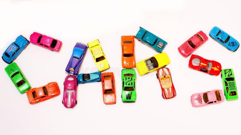 желтый цвет игрушки таксомотора автомобилей шины стоковое фото rf