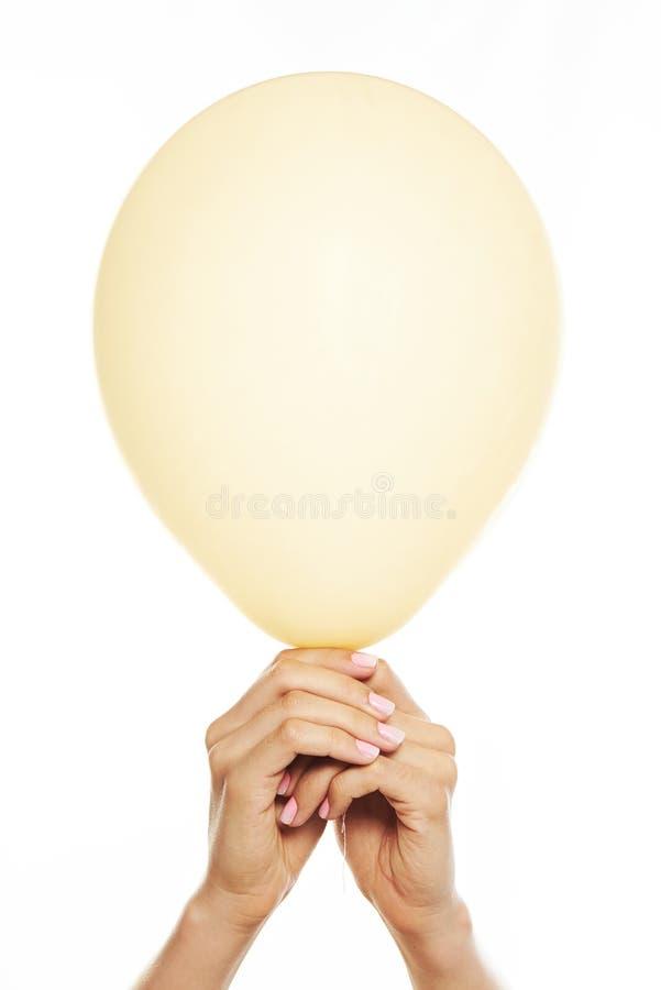 желтый цвет изолированный воздушным шаром стоковое фото