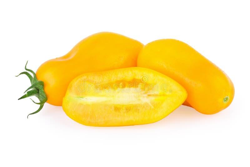 Желтый цвет томатов над белизной стоковые фото