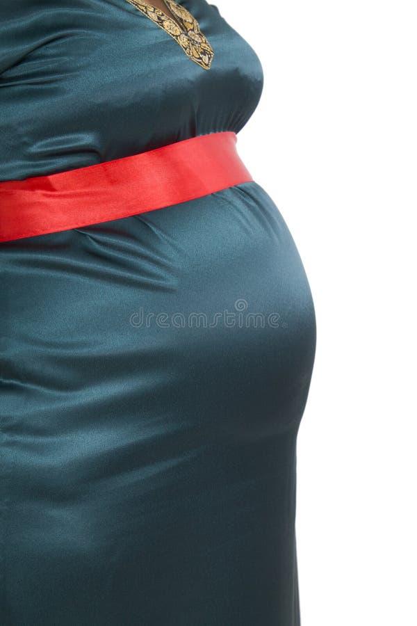 Живот беременной женщины в костюме масленицы стоковое изображение rf