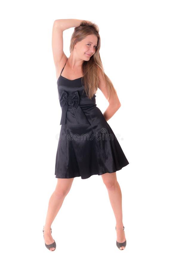 Жизнерадостная девушка в черном платье стоковое фото