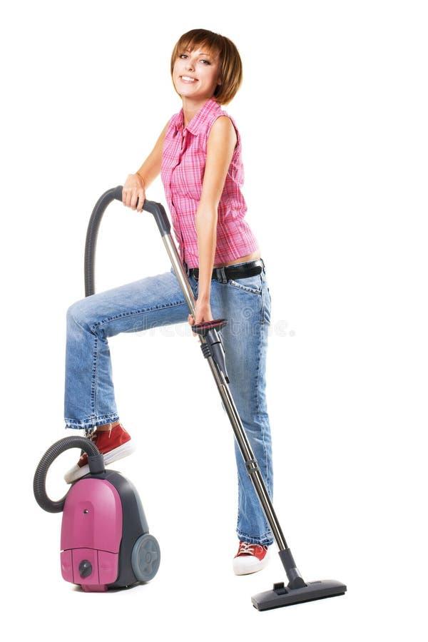 жизнерадостные детеныши женщины вакуума уборщика стоковое фото rf