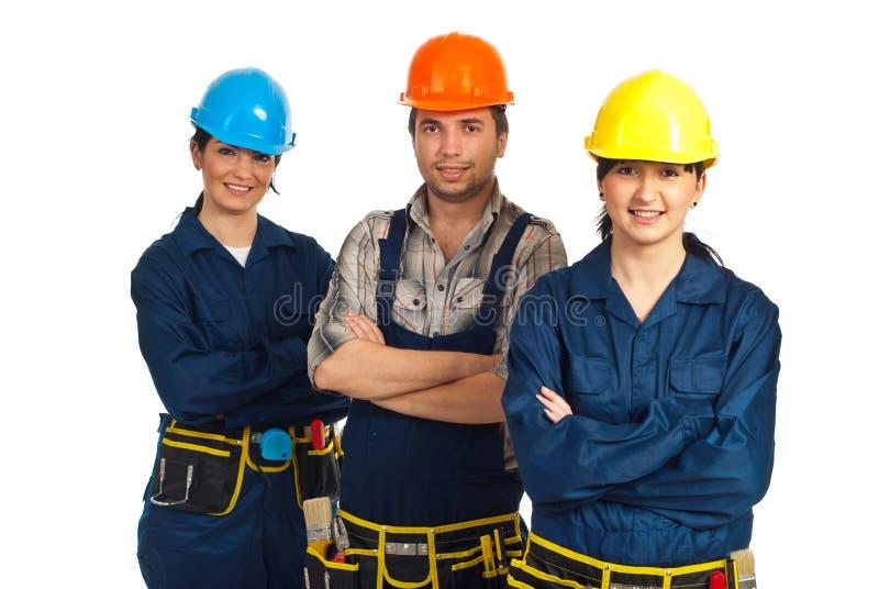жизнерадостные работники команды 3 конструктора стоковые фотографии rf