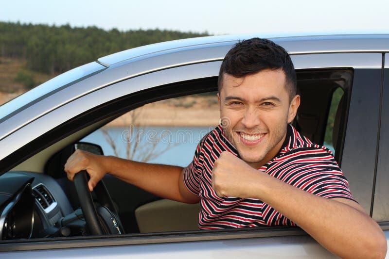 Жизнерадостный водитель празднуя победу стоковая фотография rf