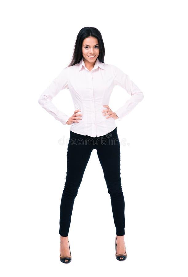 Жизнерадостная коммерсантка стоя над белой предпосылкой стоковое изображение rf
