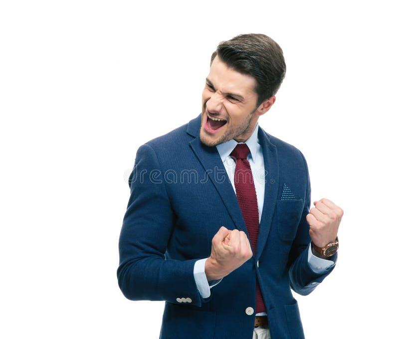Жизнерадостный бизнесмен празднуя его успех стоковая фотография