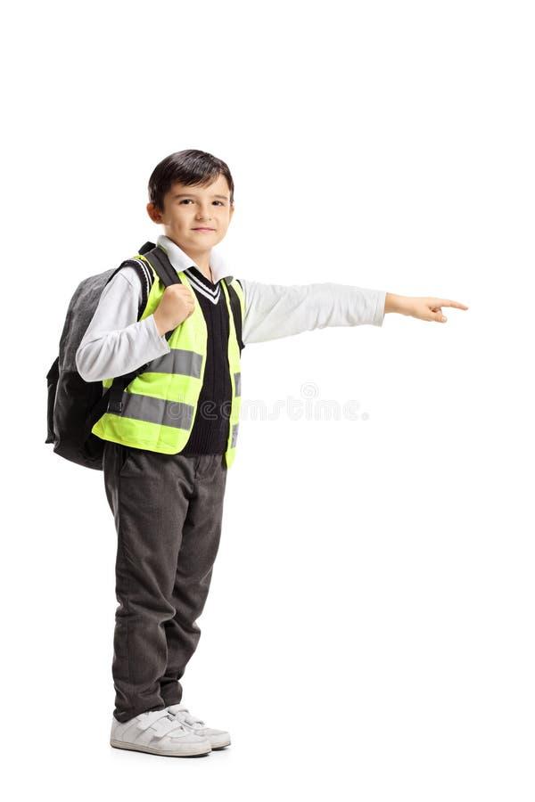Жилет и указывать безопасности школьника нося стоковые фотографии rf