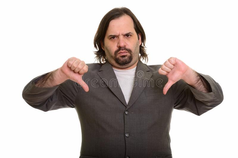 Жирный кавказский бизнесмен давая 2 большого пальца руки вниз стоковые изображения
