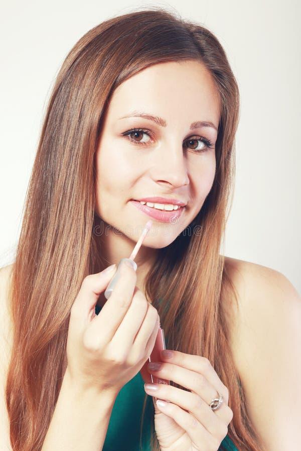 Жидкостная лоснистая губная помада стоковое фото rf