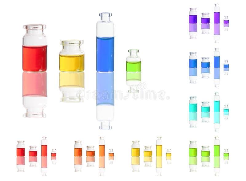 Жидкость цвета в бутылках изолированных на белизне стоковая фотография rf