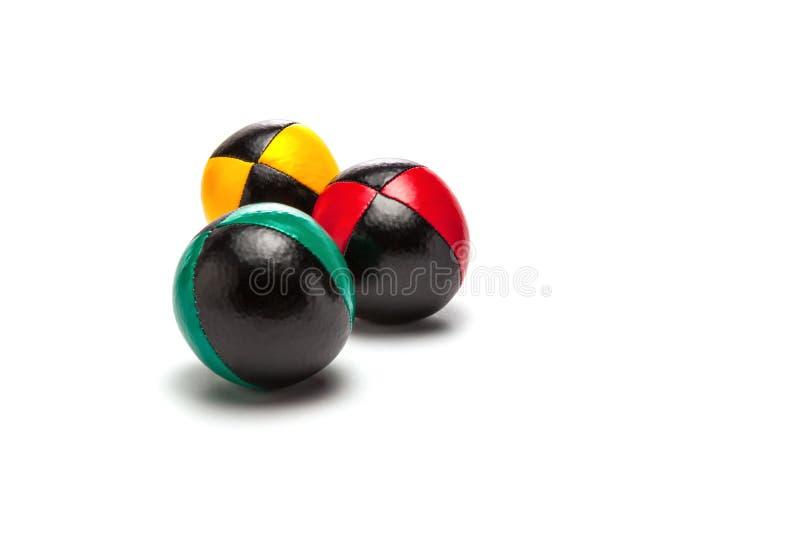 Жонглируя шарики на белой предпосылке стоковое изображение rf