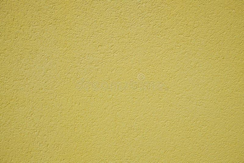 Жёлтая шероховатая поверхность настенной стены стоковое изображение rf