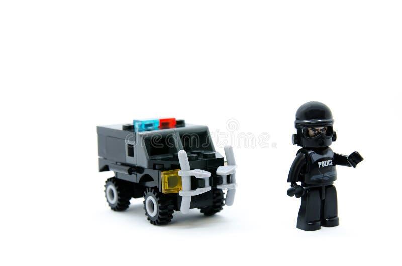Забавляйтесь зигзаг автомобиля тюрьмы полиции с офицером стоковые фотографии rf