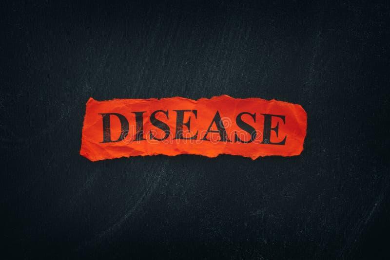 Заболевание слова на красном сорванном куске бумаги стоковая фотография