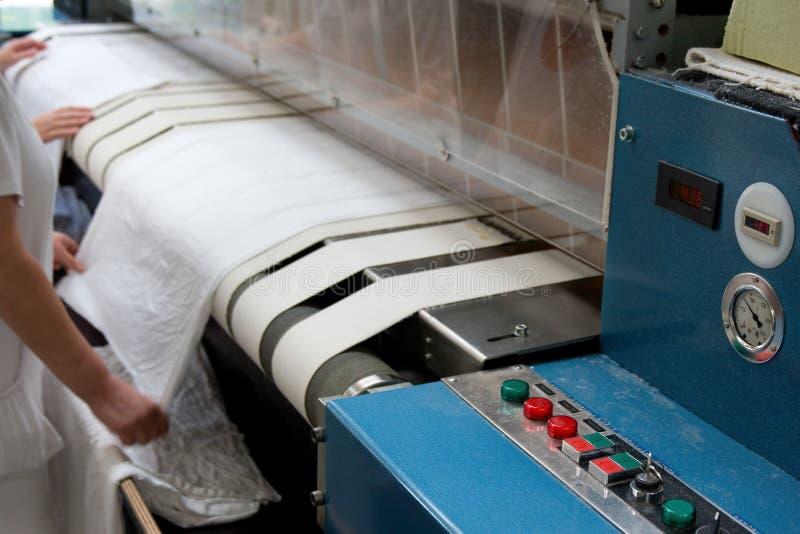 завальцовка давления засыхания утюживя стоковая фотография rf
