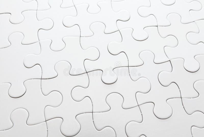 Завершите белую головоломку стоковое изображение