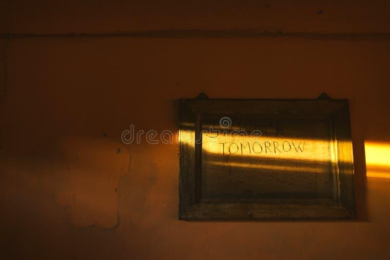 завтра Надпись в солнечном луче стоковая фотография