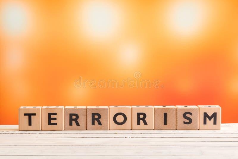 Заголовок терроризма сделанный из древесины стоковое фото
