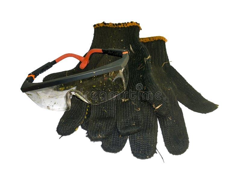 Загрязненные стекла и перчатки стоковое изображение
