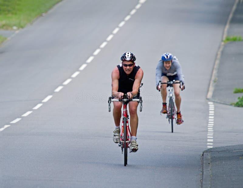 задействуя triathlon преследования стоковые фотографии rf