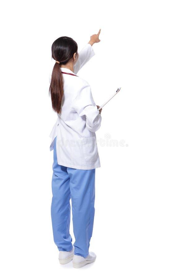 Задний взгляд пункта перста женщины доктора стоковая фотография rf