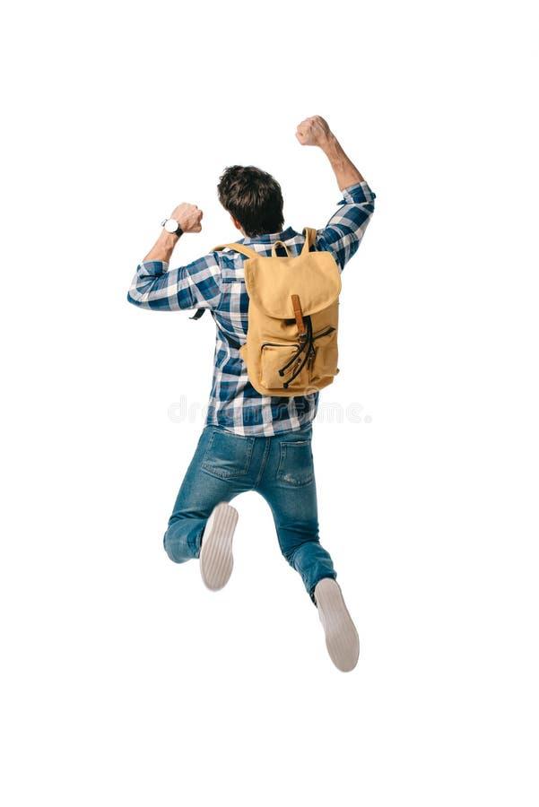 задний взгляд студента скача с рюкзаком стоковая фотография rf