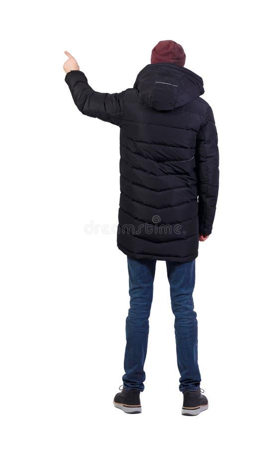 Задний взгляд человека в пунктах parka его рука стоковое фото rf