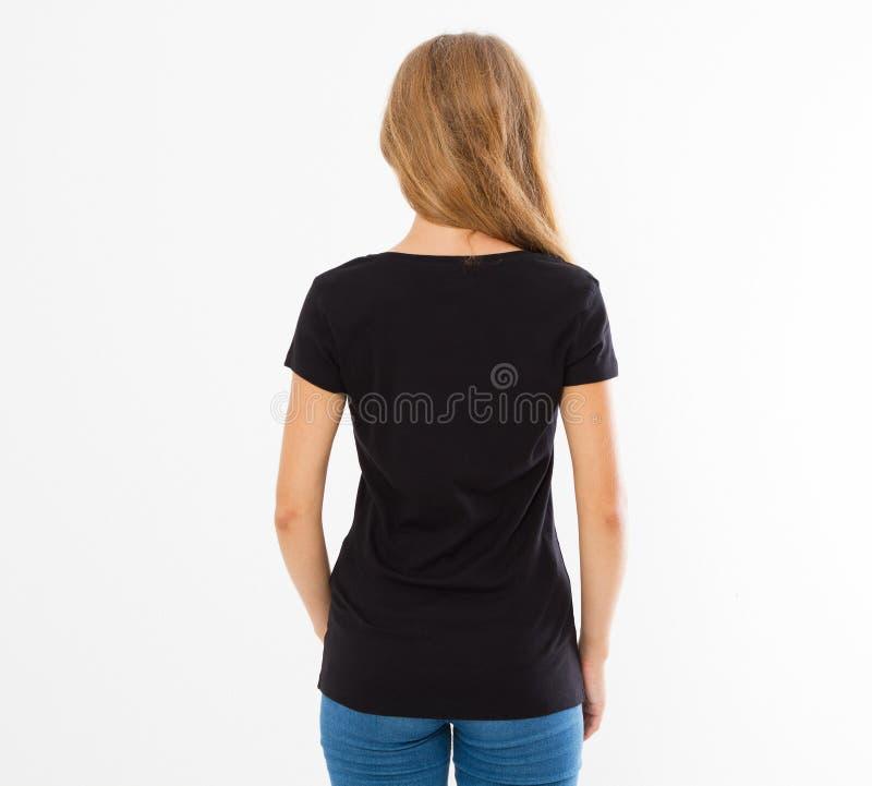 Задний вид сзади: женщина в черной футболке изолировала, девушка в насмешке футболки вверх, черная футболка Футболка Midsection ж стоковое фото